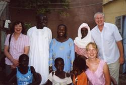 Older volunteers with host family in senegal
