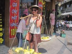 Volunteer carrying fruit