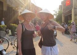 Volunteers in traditional hats